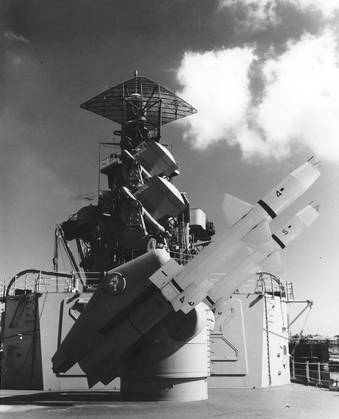 """USS Little Rock (CLG-4) trains out her new nuclear-tipped """"Talos"""" guided missiles in 1962. Converted from a Cleveland Class light cruiser at New York Ship from 1959-1960, Little Rock was one of only two ships to carry the massive SPS-2 tringular shaped radar. With a range in excess of 70 miles, """"Talos"""" was the Navy's premier surface to air missile systems in the 1960's."""