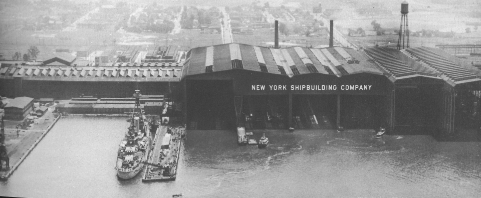 A waterfront view showing New York Ship's distinctive covered ways under which work can be carried on relatively independent of the weather.