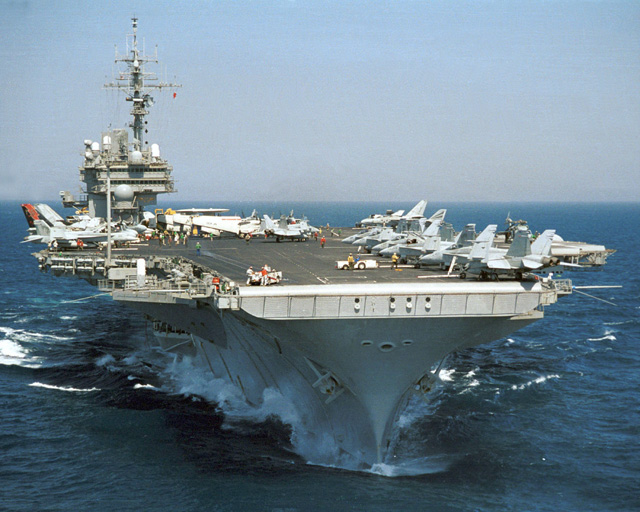 The 60,000 ton, New York Ship built aircraft USS Kitty Hawk (CV-63) pictured in the western Pacific Ocean in 2003. Over its forty year career, Kitty Hawk has operated off Vietnam, Desert Shield, Desert Storm, and Operation Iraqi Freedom.